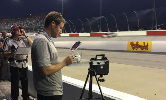aerial cinematography drone filming a nascar race